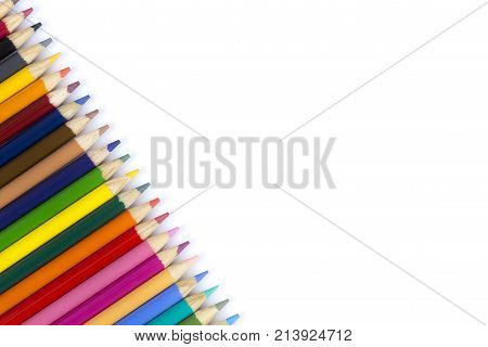 Many colored pencils on isolation. Pencils on white background next to each other. Multicolored pencils diagonally in a row