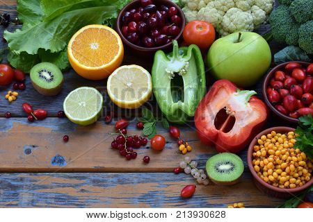 Composition of products containing ascorbic acid vitamin C - citrus cauliflower broccoli sweet pepper kiwi dog rose tomatoes apple currant sea buckthorn dogwood. Top view. Flat lay poster