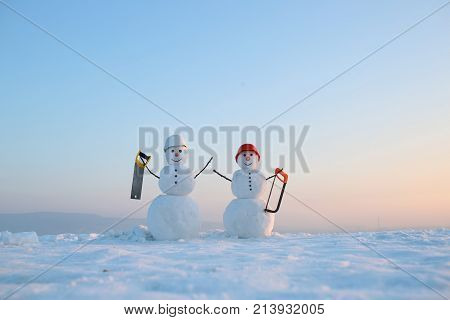 Snowman Builder In Winter In Helmet.