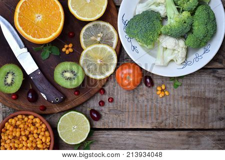 Composition of products containing ascorbic acid vitamin C - citrus cauliflower broccoli sweet pepper kiwi tomatoes sea buckthorn. Top view. Flat lay poster