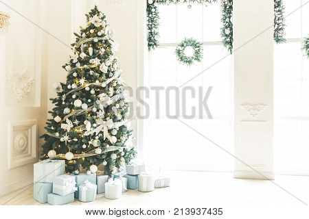 Christmas Living Room With A Christmas Tree, Gifts And A Large Window. Beautiful New Year Decorated