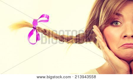 Emotions expressions sadness concept. Teenage girl in blonde braid windblown hair making sad face.