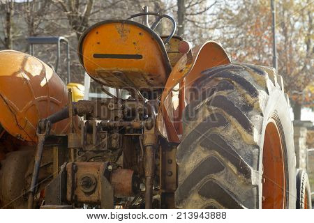 Old vintage farm tractor, exposed in a country fair in the hilly region of Langhe (Piedmont, Northern Italy); world famous for its valuable wines (Barolo, Roero and Barbaresco first), Langhe Monferrato and Roero are UNESCO World Heritage Site since 2013.