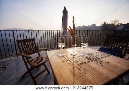 White wine tasting in the village of Castiglione Falletto (hilly region of Langhe, Piedmont, Northern Italy), in a terrace over the countryside; world famous for its valuable wines (Barolo, Roero and Barbaresco first), Langhe Monferrato and Roero are UNES