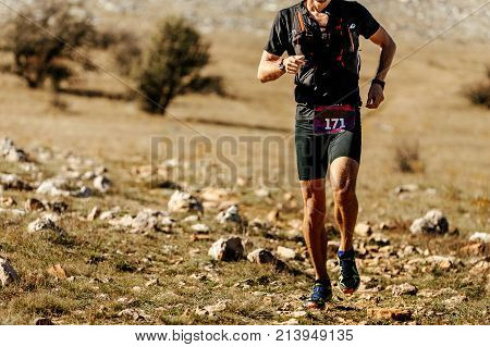 man athlete runner leader of mountain marathon running stones trail