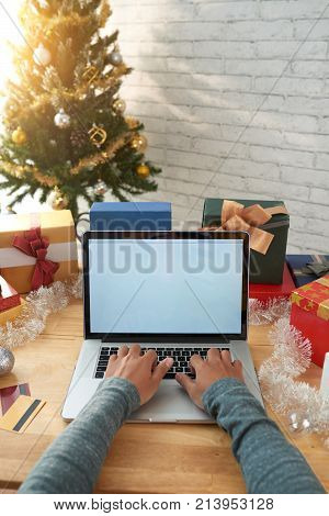 Hands on man buying presents for everybody online