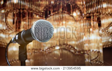 Blurred of microphones in seminar room talking speech in conference hall light with microphone and keynote. Speech is vocalized form of communication humans vintage tone