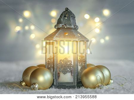 Christmas background with lantern and balls.
