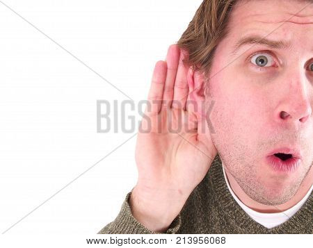 a man holding his ear listening for sound.