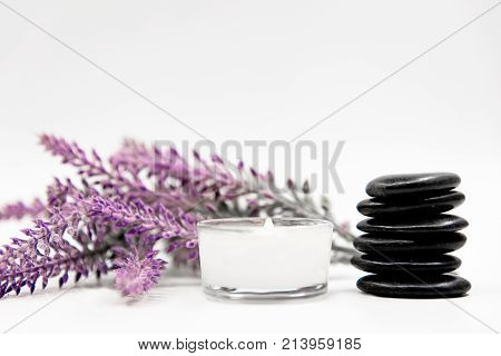Lavender aromatherapy Spa with rock spa and candle. Thai Spa relax Treatments and massage white background. Healthy Concept. select and soft focus