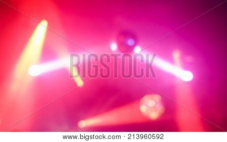 Blurred disco ball inside club with colorful laser lights - Defocused image - Concept of nightlife with music entertainment - Original color bokeh