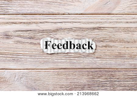Feedback of the word on paper. concept. Words of Feedback on a wooden background.