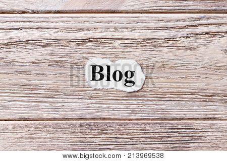 BLOG of the word on paper. concept. Words of BLOG on a wooden background.