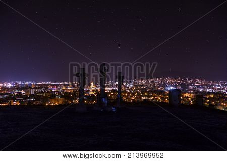 City night in Nitra from the view point on top of Hill (mountain) Slovak city Nitra with purole night sky and crosses. City center at night with buildings and churches. City at night with stars