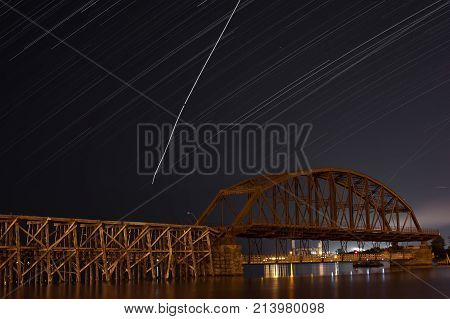 star trail over rice's point in duluth, minnesota