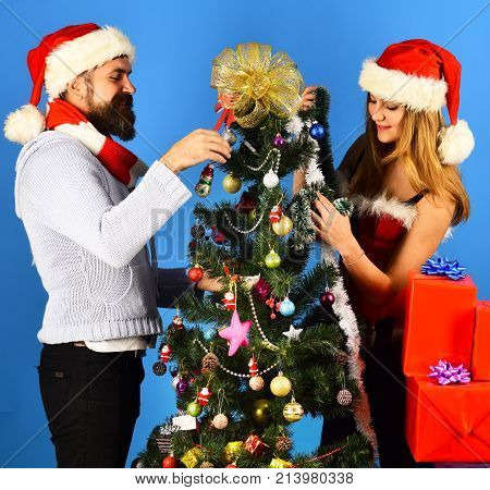 Santa And Sexy Girl Or Couple In Love Decorate Tree