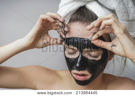 Woman remove black mack.Face scrab,exfoliation pores,clean skin