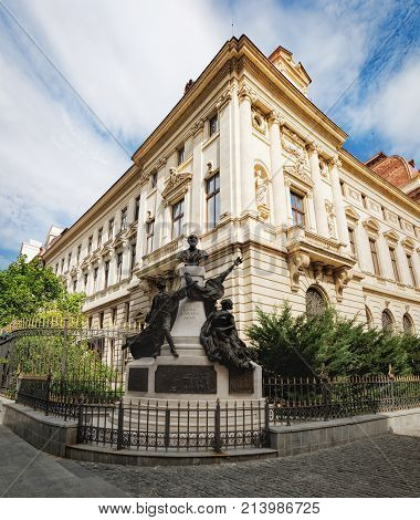 Bucharest, Romania - September 9, 2017: Monument to Eugeniu Carada and the ancient architecture of historical center Lipscani Street in Bucharest, Romania.