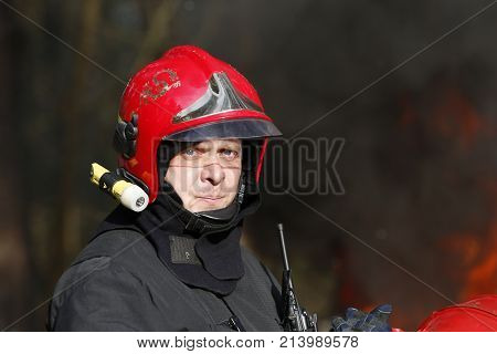 Belarus, Gomel City. Firefighting Of The Forest 06.04.2017.the Brave Fireman Will Extinguish The Fir