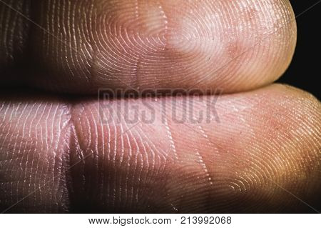 macro view of the finger's fingertips in the darkness