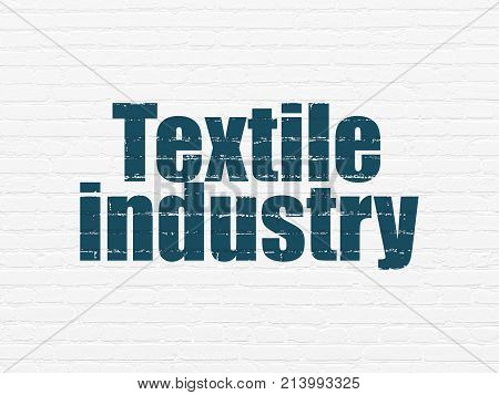 Manufacuring concept: Painted blue text Textile Industry on White Brick wall background