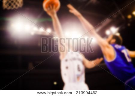 scoring during a basketball game - ball in hoop - blurred image