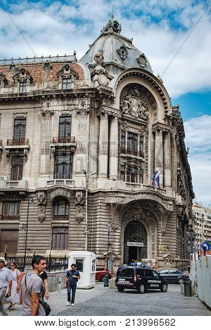 Bucharest, Romania - September 9, 2017: Tourists visiting the historical center of Bucharest with its beautiful architecture, Romania. There is an antique shop in the ancient building