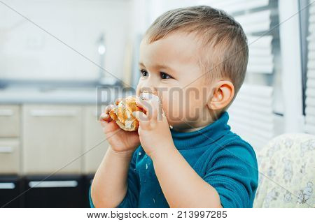 Baby In The Kitchen Eagerly Eating The Delicious Cream Horns, Vanilla Cream