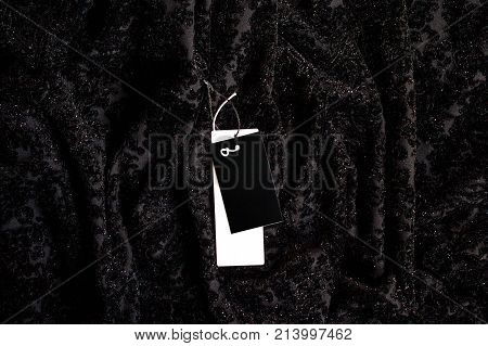 Black friday. Sale tag on the velour shines background.