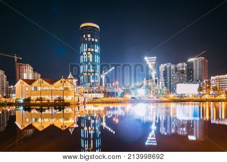 Batumi, Adjara, Georgia. Construction And Development Of Modern Multi-storey Residential Buildings And Hotels Near The Black Sea Coast In Night Illuminations Lights. Illuminated Resort Town At Evening