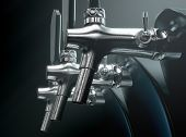 A row of slick modern black and chrome draught beer taps on an isolated dark moody studio background - 3D render poster