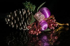 A Christmas Tree Conifer Cone Decoration On A Reflective Surface