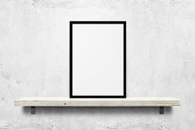 White blank photo frame mockup on shelf over white concrete wall background