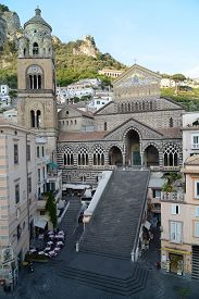 Apostle Saint Andrew Cathedral in Amalfi (Italy) - gold decorated facade with church stairway.