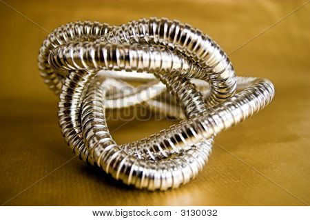 Silver Abstract Shape On Gold Background
