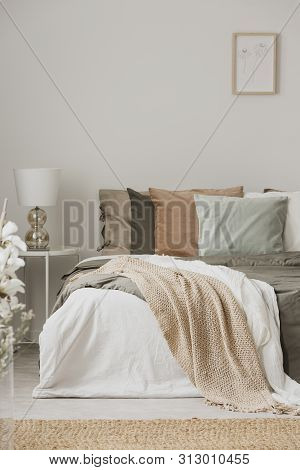 Earth Colors In Stylish Bedroom Interior With King Size Bedr