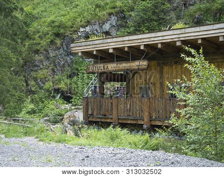Slovakia, Western Tatra Mountain, July 2, 2019:wooden Shelter Barborka With Rock And Forest Next Tun
