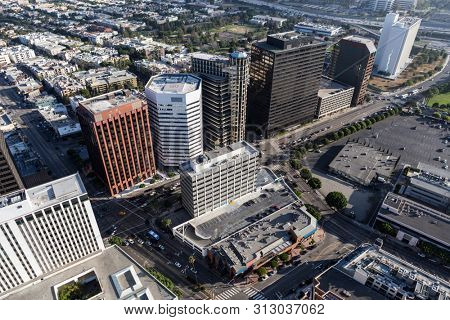 Aerial view of buildings along Wilshire Blvd near Westwood and the 405 freeway in Los Angeles, California.