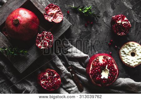 Fresh Pomegranate In A Wooden Box. On A Gray Background. Top View. Copy Space. A