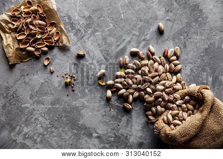 Roasted Pistachios On Natural Wooden Table Background A