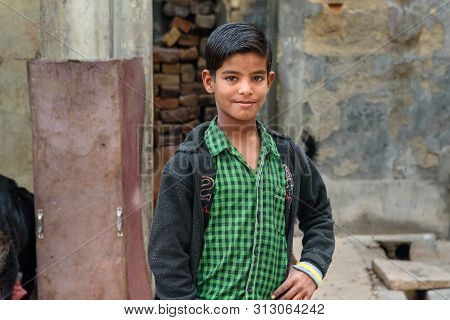 Bikaner, India - February 11, 2019: Portrait Of Indian Young Boy On The Street In Bikaner. Rajasthan