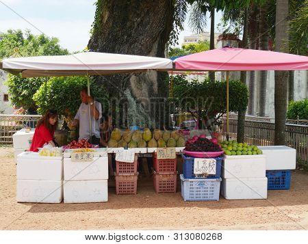 Malacca, Malaysia--febuary 2018:  Vendors Sell Assorted Fruits Like Durian, Mango And Others Outside