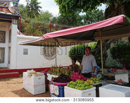 Malacca, Malaysia--febuary 2018: Vendors Sell Fresh Fruits Like Durian, Mango And Others Outside The