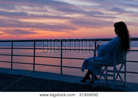 A Woman Watching The Mythical Colorful Sunset