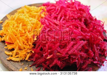 Grated Beets And Carrots. Background From Grated Beets And Carrots. Grated Vegetables. Food