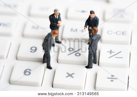 poster of Business mans standing on calculator. Interest rate financial and mortgage rates. Compound interest rate calculation. Risk management financial and managing investment percentage interest rates.
