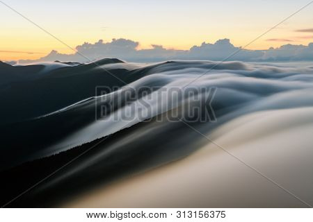 Amazing morning fog in mountains blurred from long exposure. Landscape photography
