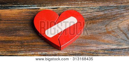 A Red Heart With A Plaster. Renewal Of The Relationship. Family Psychotherapist Services. Reconcilia