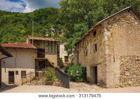 The small historic hill village of Drenchia Inferiore in Friuli-Venezia Giulia, north east Italy poster