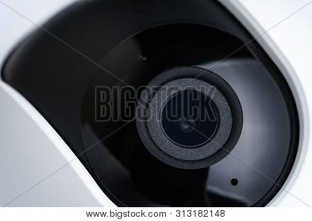 Closed Up View Of Internet Ip Video Camera With Small Wide Angle Lens With White Plastic Cover Using